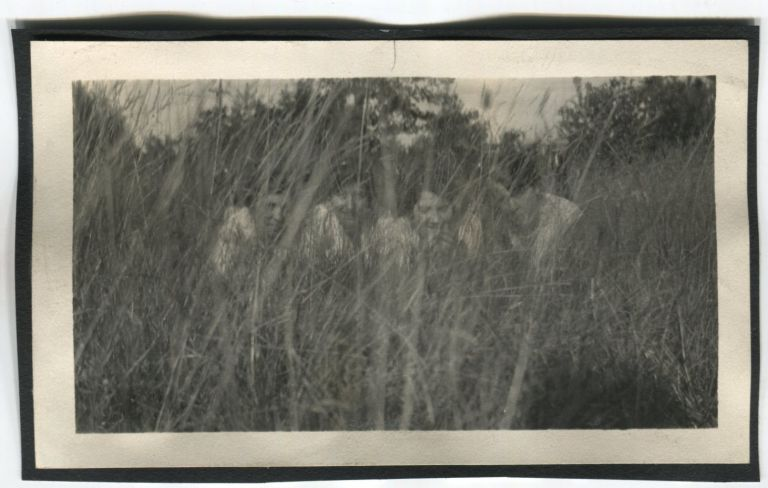 FOUR YOUNG WOMEN HIDING IN THE GRASS VINTAGE SNAPSHOT PHOTO