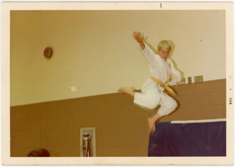 KARATE BOY SHOWS OFF MOVES MID-AIR VINTAGE COLOR SNAPSHOT PHOTO