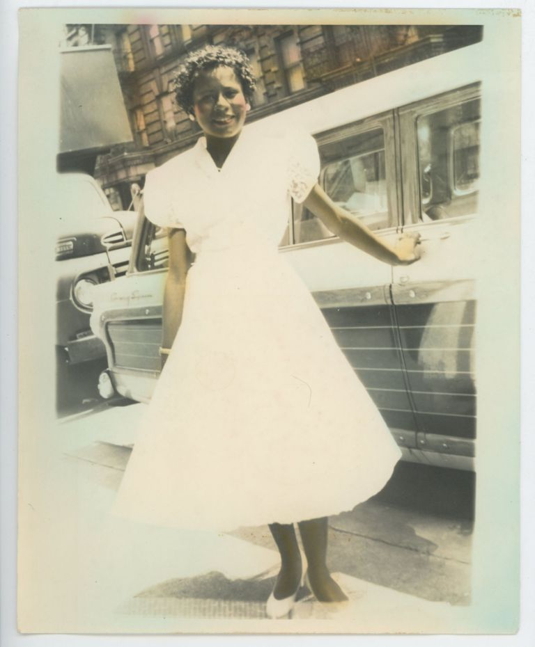 HAND-TINTED PHOTO of a BLACK WOMAN on a CITY STREET 1950s