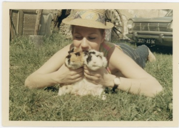 WOMAN HOLDS TWO GUINEA PIGS VINTAGE COLOR SNAPSHOT PHOTO