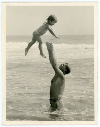 GIRL MID AIR AS FATHER CATCHES HER SNAPSHOT PHOTO